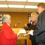Antioch Councilwoman Mary Rocha gives the oath of office to Joy Motts as her brother Kerry Motts holds the Bible.