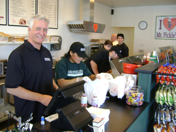 Owner Bill Byrnes and staff Mr. Pickles Sandwich Shop Opens in Antiochs Bluerock Center