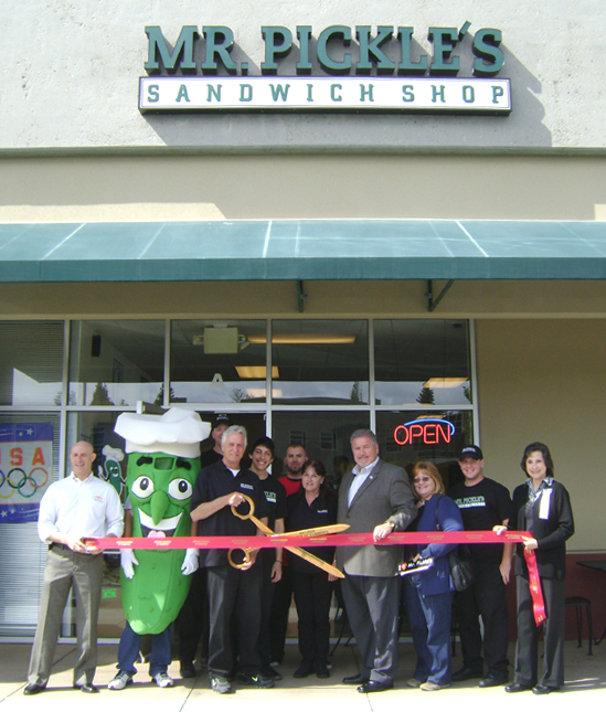Owner Bill Byrnes prepares to cut the ribbon Mr. Pickles Sandwich Shop Opens in Antiochs Bluerock Center