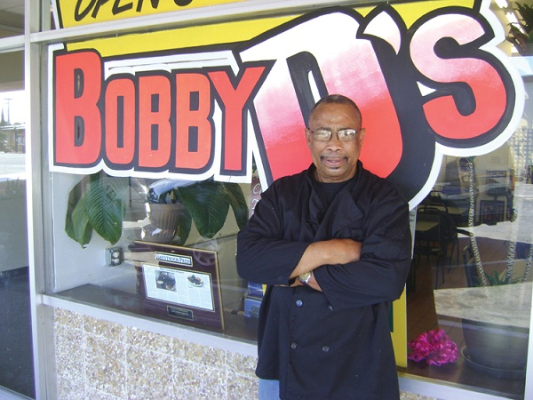 Bobby D Duncan in front of his restaurant Bobby D's is Smokin