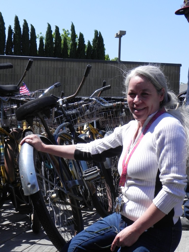 Suzie Dove of Delta 2000 with Dows donated bikes 768x1024 Dow Donates Dozens of Bikes to Delta 2000