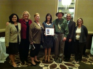 Stacey Wickware, history teacher at Dozier-Libbey Medical High School displays her plaque of recognition as the 2011-2012 Antioch Teacher of the Year at the Contra Costa County Teacher of the Year dinner, September 21, 2012 at the Concord Hilton.  Honoring her are (left to right) County Board of Education President Cynthia Ruehlig, Antioch School Board Vice President Joy Motts and President Diane Gibson-Gray, honoree Stacey Wickware, Antioch Board Member Walter Ruehlig, A.U.S.D. Superintendent Dr. Donald Gill  and Dozier-Libbey Principal Nancie Castro.