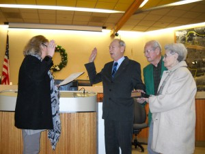 Outgoing City Clerk Denise Skaggs administers the Oath of Office to new Antioch City Clerk Arne Simonsen, as his parents Otis and Betty Simonsen hold his grandfather's Bible.