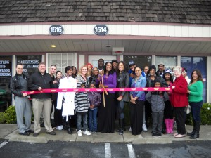 Representatives of the Antioch Chamber of Commerce join Simone Theus, center, her family and friends, at the ribbon cutting of Simone's Double Double Day Spa in Antioch on Saturday, December 1st.