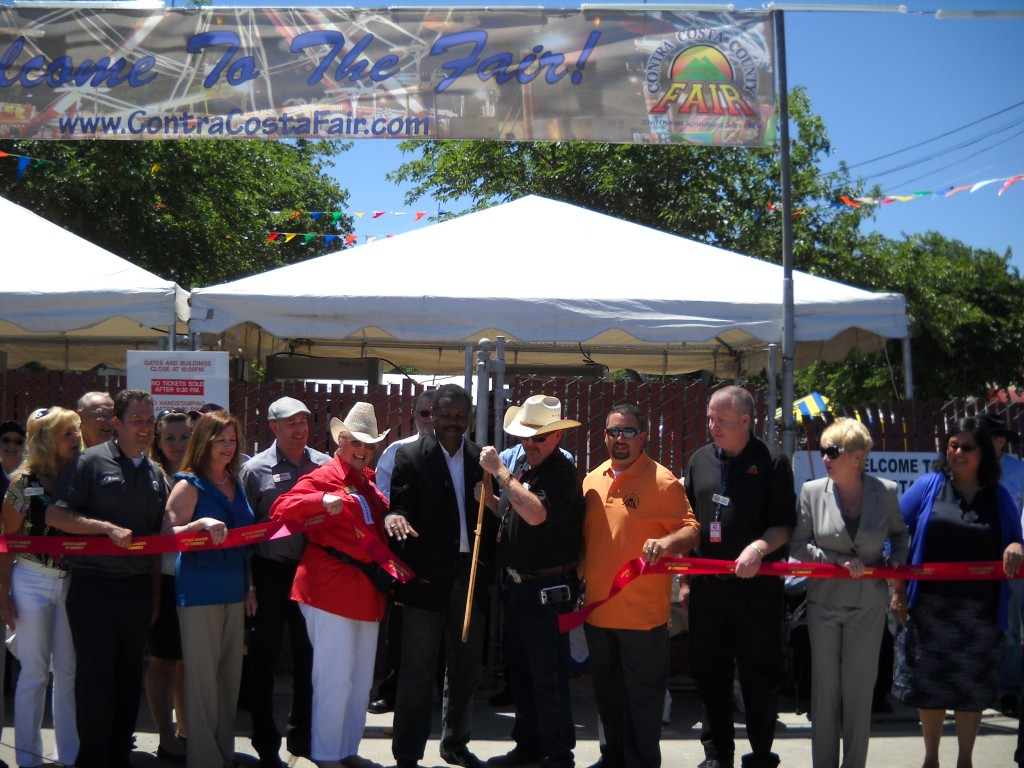 Steve Limrite, President of the Contra Costa Fair Board, along with Antioch Mayor Wade Harper, other Board members and Antioch Chamber of Commerce representatives cut the ribbon marking the official opening of the 2013 Contra Costa County Fair.