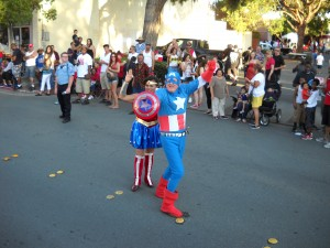 Cynthia & Walter Ruehlig aka Wonder Woman & Captain America participate in the July 4th parade.