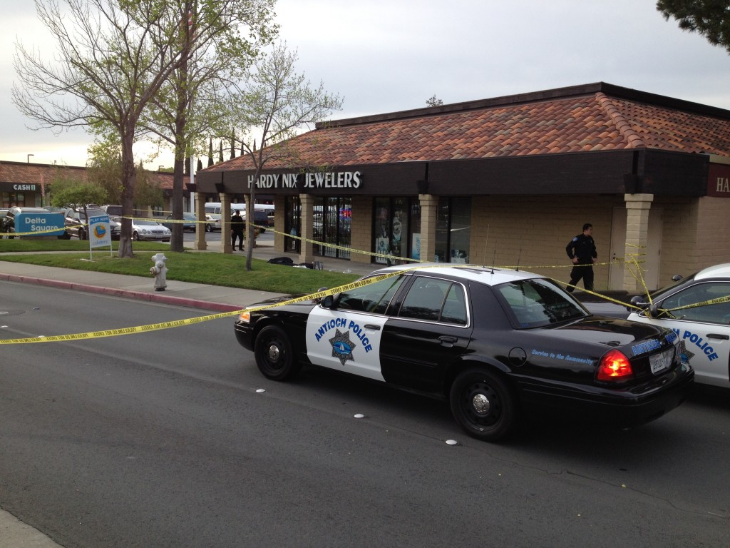 Police cordoned off the area around the Hardy Nix Jewelry store in Antioch after a robbery on Friday. One thief was shot and died in front of the store. By Allen Payton