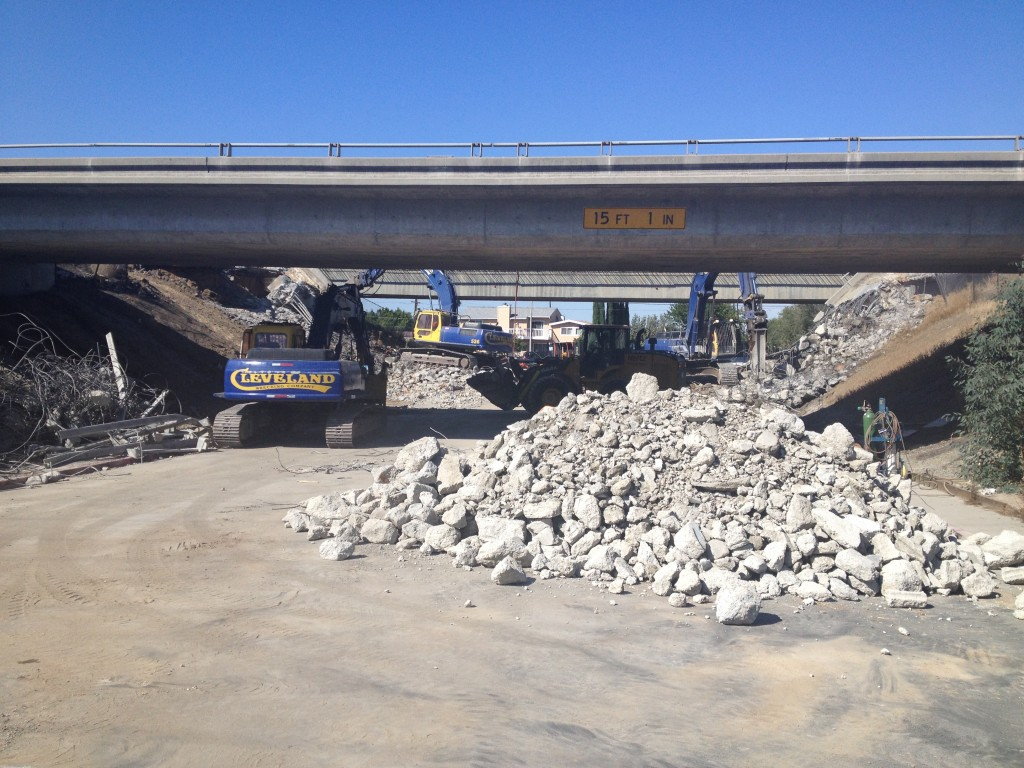 Demolition crews tear down the old Highway 4 overpass above Cavallo Road, and clean up the debris on Saturday, September 27, 2014.