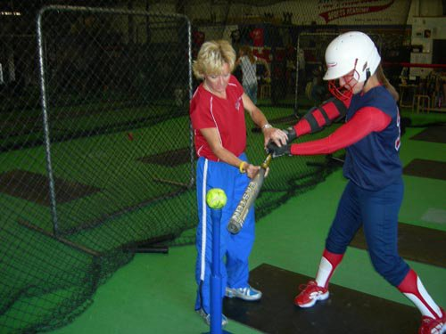 Debbie coaching batting Antioch softball Sports Legend opens training and practice center