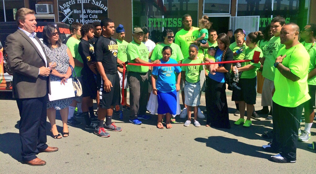 Owner Marcus Malu gives speech before cutting the red tape Malu Fitness celebrates Grand Opening in Antioch, gives back to community