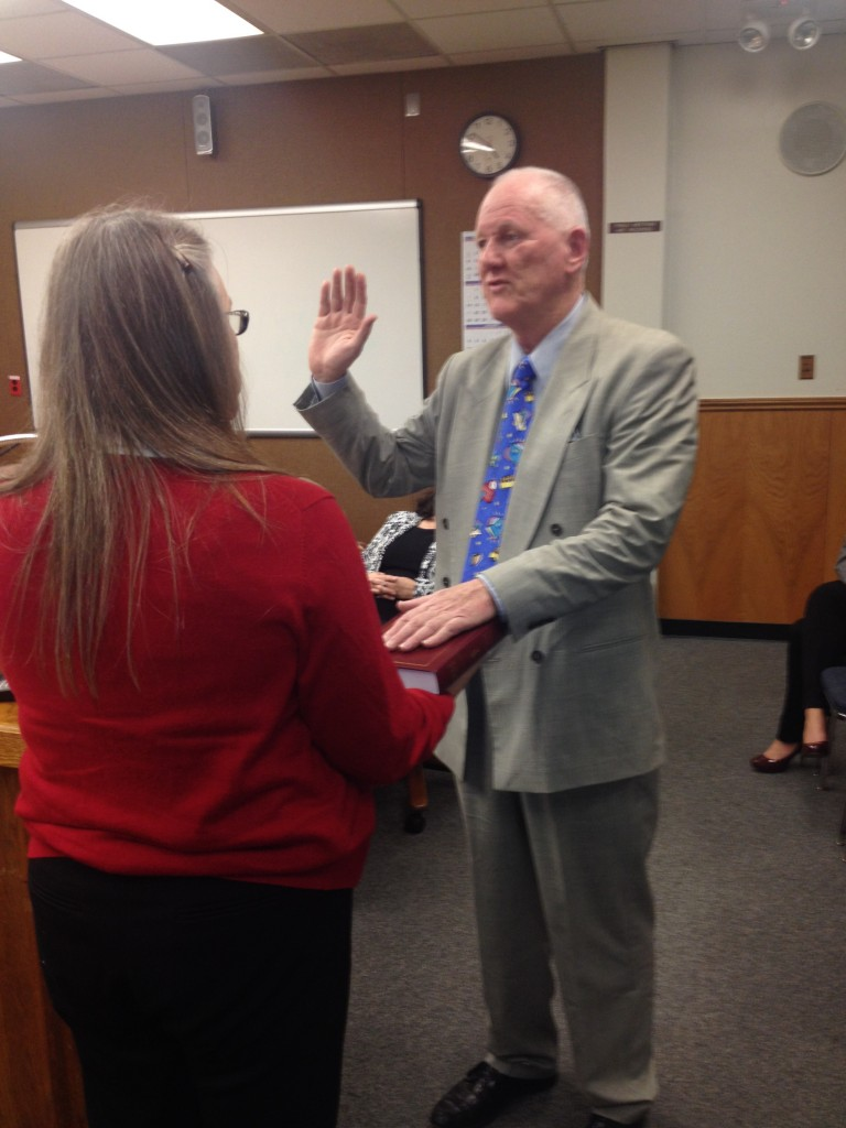 Walter Ruehlig takes oath 768x1024 Ruehlig, Vinson take their seats on the Antioch School Board