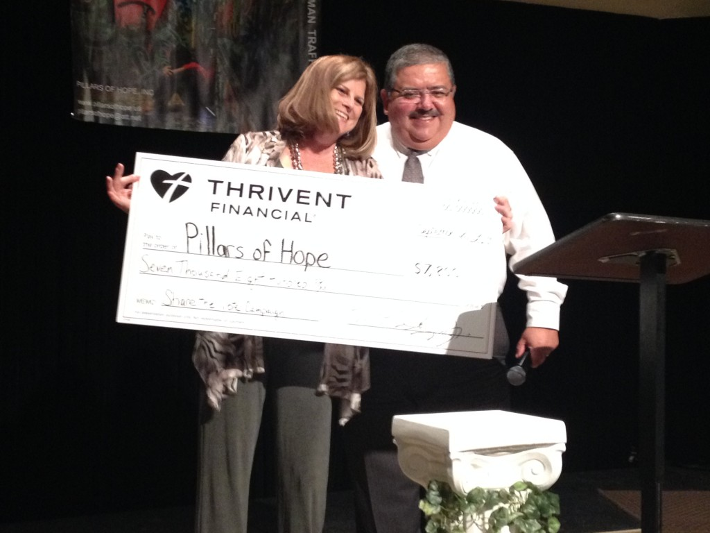 Debra Brown displays the check presented to her by Manny Soliz, Jr. at a fundraiser last fall.