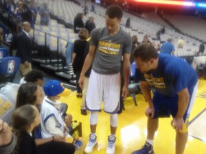 Kapri meets Stephen Curry and St. Jude NBA Ambassdor David Lee. Photo by F.D. Purcell