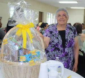 One grandma with the gift basket she won