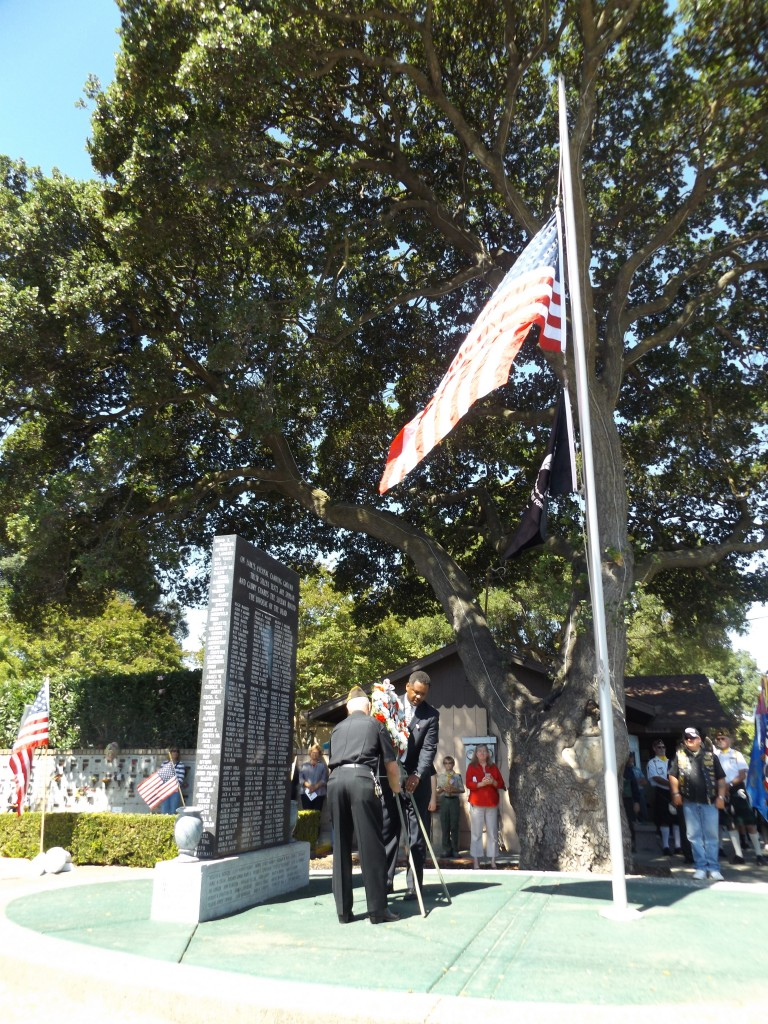 Mayor Wade Harper and Commander Henri Veilleux of the VFW Post place the wreath at the Memorial Day ceremony.