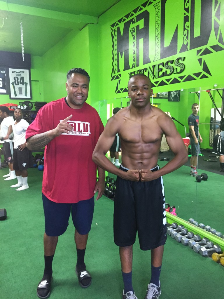 Isaiah Foskey flexing next to trainer Mori Suesue at Malu Fitness. 768x1024 Antioch 8th grader offered college football scholarship