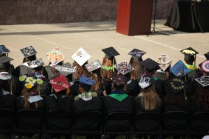 Dozier-Libbey Class of 2015 graduates with their decorated caps. photo by Luke Johnson