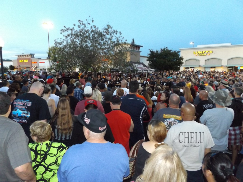 "The crowd at the candelight vigil for Jeremy ""Lumpy"" Sturgill gathers in front of Lumpy's Diner in Antioch, and listens to his father Dave ""Digger"" Sturgill speak, Friday night, June 19, 2015."