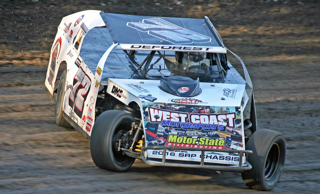 (071815) Antioch Speedway Action - Shawn DeForest of Livermore slides through the high-banked turns of the Antioch Speedway clay oval in route to winning the IMCA modified feature Saturday night.  (Antioch, CA)