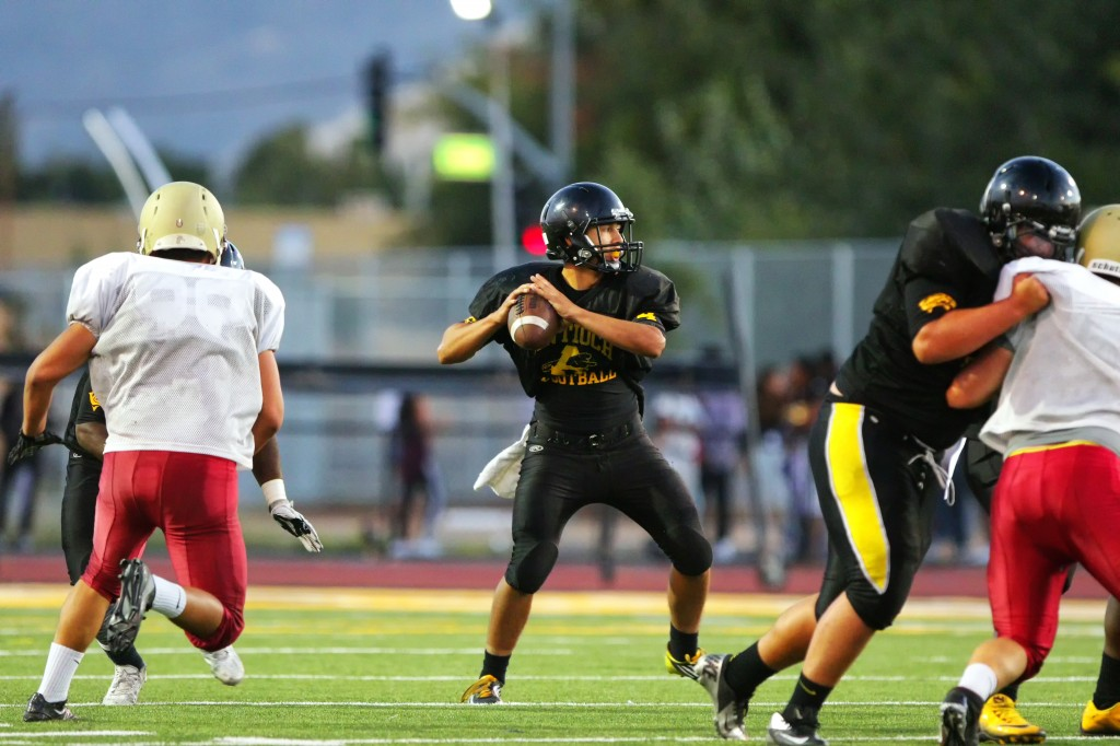 Antioch High quarterback, junior #4 Abram Karnthong, in scrimmage vs. Northgate, Friday, August 21, 2015. photo by Luns Louie, DeltaSportsMag.com.