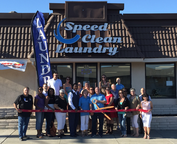 Representatives from the Antioch Chamber of Commerce, City Council and School Board join the Spangenberg family for the ribbon cutting to officially open their new business.