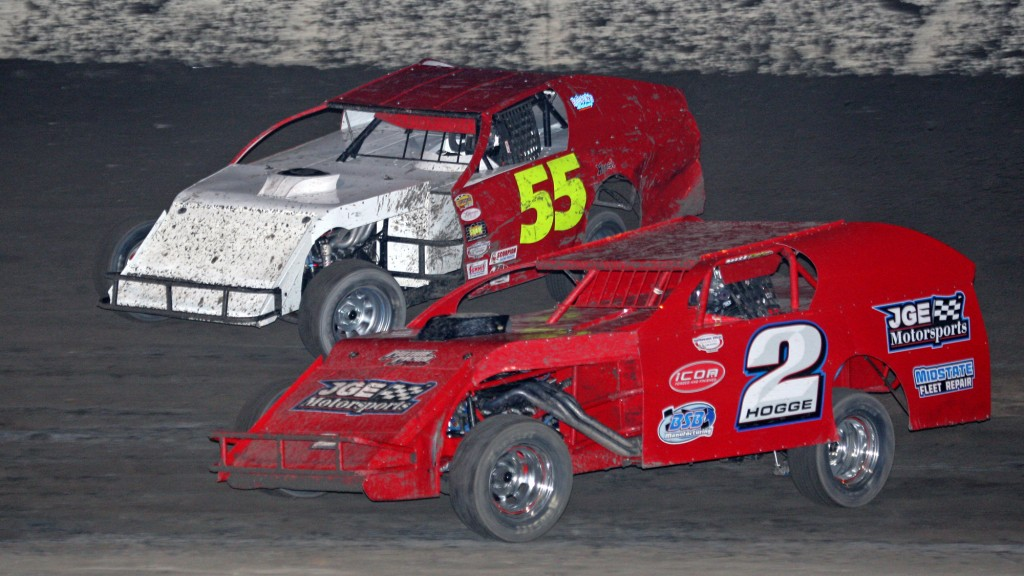 (092615) Antioch Speedway Action -  Bobby Hogge IV (2) of Salinas passes Livermore's Bran Cass for the lead in the first leg of the Delta-Valley Classic Saturday night at Antioch Speedway. Hogge IV went on to win both legs of the annual event with his San Jose-based car. He won Sunday night at Merced Speedway, collecting a bonus for the unlikely feat. Hogge IV has won both legs of the event twice in four years. photo by Mike Adaskaveg
