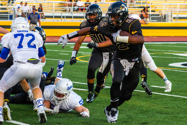 Antioch's Najee Harris breaks through the Acalanes defense. photo by Michael Pohl