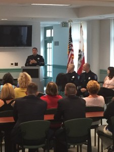 Chief Cantando speaks at the ceremony, as new officers Harris and Downie, and newly promoted Dispatch Supervisor Stacey Malsom, friends, family and Antioch council members look on.