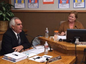 Dr. Don Gill speaks of his announced resignation while Antioch School Board Trustee Diane Gibson Gray listens, during Wednesday night's meeting.