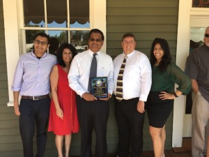 Chamber CEO Dr. Sean Wright (center right) Devon, Ursula, with Rodney (with plaque), and Nicole Lal.