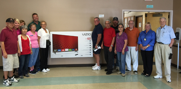 Members of the Antioch Rotary Club present a new, 60-inch TV to representatives of the Antioch Senior Center on Friday, Sept. 25.