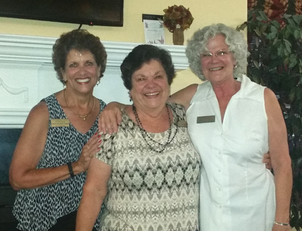 "AEWF Board Chairwoman Sharon Pappas and Executive Director Mary Chapman with Board Member Julie St. Andrews, the mother of the $1,000 prize winner, Amanda Stockford, in the organization's ""Fund A Wish"" fundraiser."