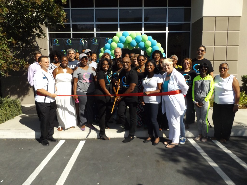 Representatives from Antioch Chamber of Commerce and City Council join Church@Antioch Pastor Chris Williams (with scissors), his wife Emery, and members of the A Team from their church to cut the ribbon at their new offices on Saturday, September 26, 2015.