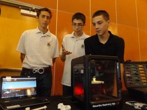 Hudson Preece, Kevin Roldan and Robert Gochenouer, juniors in the Antioch High EDGE Academy explain the workings of the 3D printer at their display.