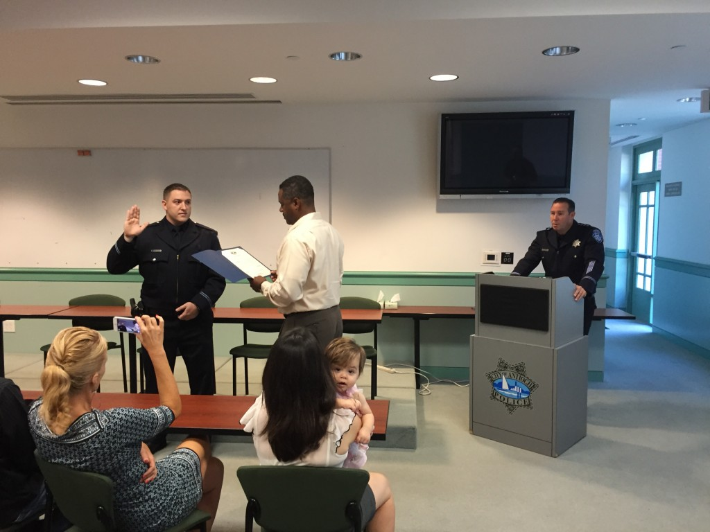 New Antioch Police Officer Justin Hamilton is administered the oath of office by Mayor Wade Harper as Chief Allan Cantando and Hamilton's family look on, during a ceremony on Monday, October 12, 2015.
