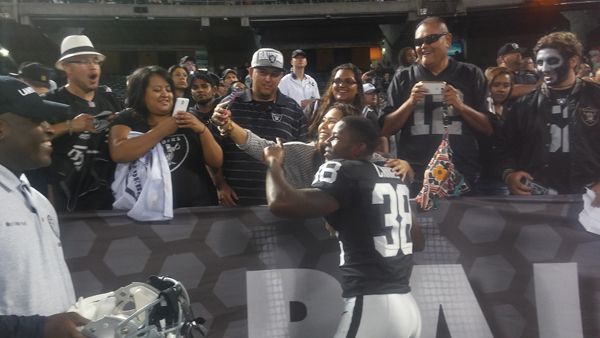 TJ Carrie takes the time to take a selfie with a Raiders fan after a pre-season home game.