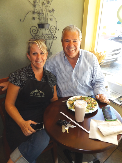 Owner Lynn Kutsal with one of her long time customers, Antioch businessman Isaac Negrin, as he enjoys a salad at Nature's Bounty, recently.