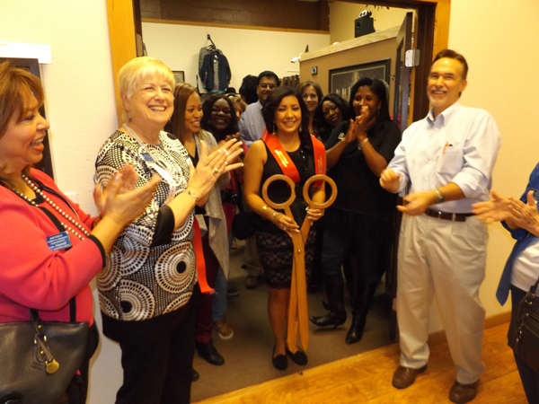 Everyone cheered after Zendy Garcia cut the ribbon officially opening her new store, Zendy's Boutique.