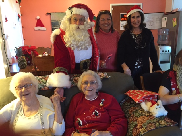 Residents of Cobblestone Care Home in Antioch, Hazel Shelton and Fern Chisum are greeted by Santa (aka Angelo Pappas), Manager Angie Ramandanen and AEWF Board Member Sandy Fredrickson during the Santa for Seniors on Wednesday, December 16, 2015.