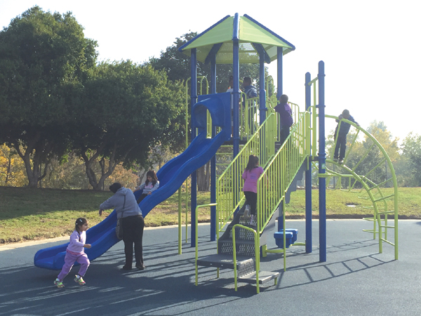 Children play on the new playground at Contra Loma Estates Park, Saturday, November 20, 2015.