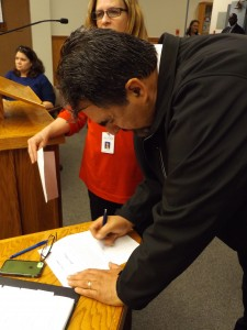 Fernando Navarro signs his Oath of Office to officially become Antioch's newest schools trustee.