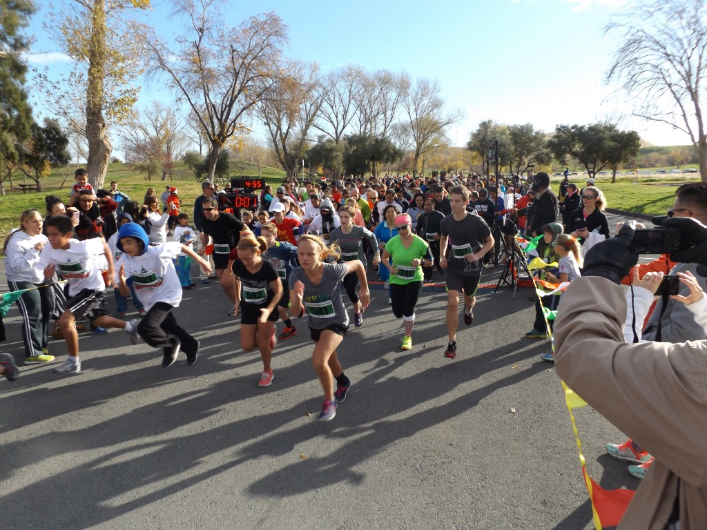 Runners begin the 10K race at the annual Holiday Run & Walk for Health at Contra Loma Regional Park in Antioch on Saturday, December 12, 2015.