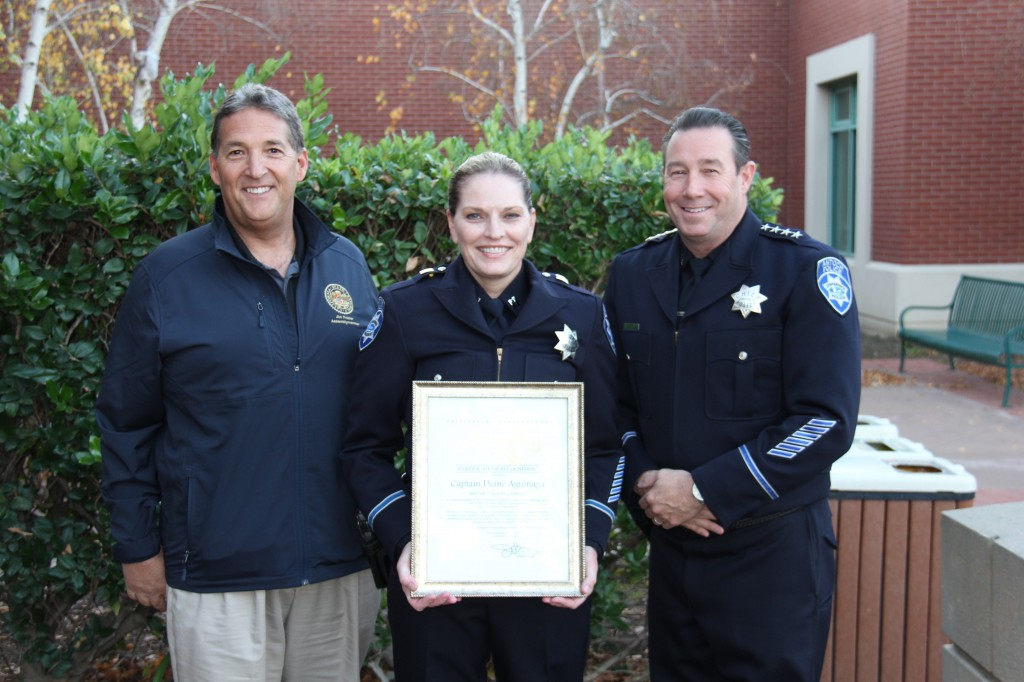 Captain Diane Aguinaga, with Chief Allan Cantandon, right, holds a certificate of recognition from Assemblyman Jim Frazier, left for her promotion, Tuesday, December 15, 2015. photo by Detective Ron Krenz.