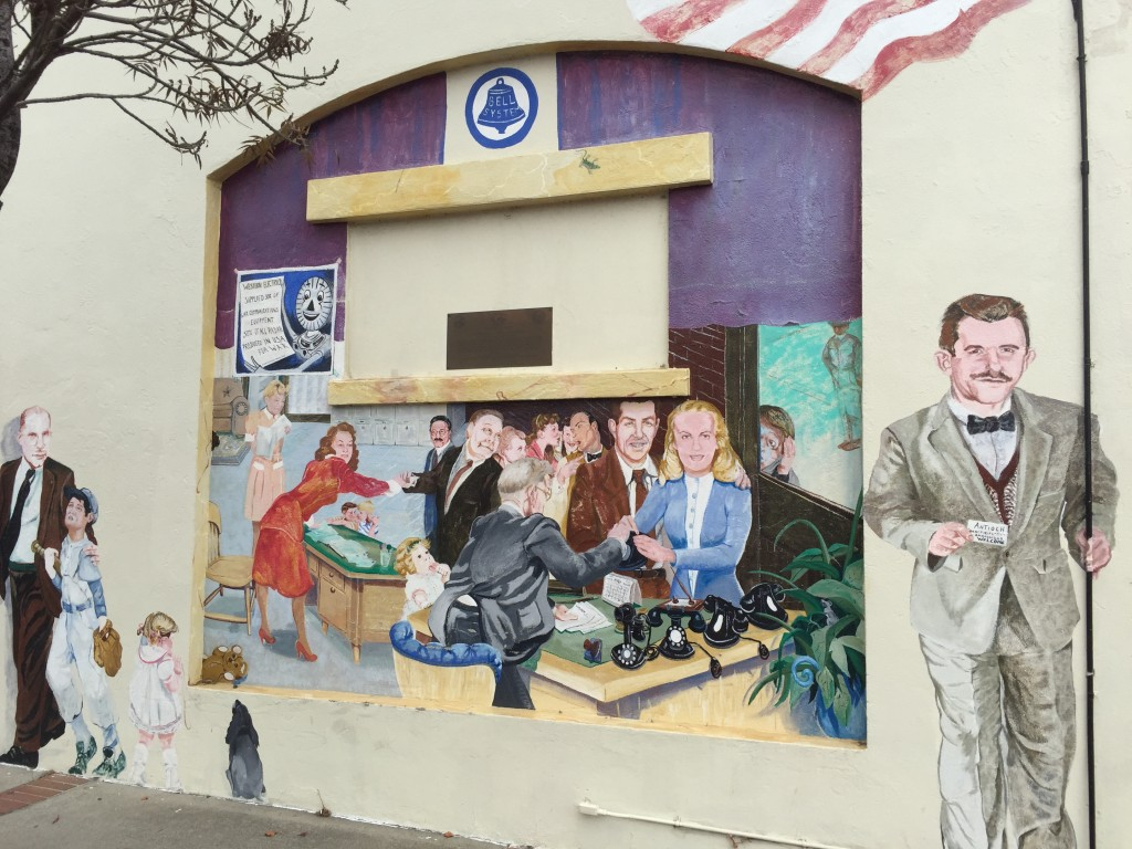 Mural of the old Antioch telephone office, depicting Don (in brown suit) and Helen (in blue and white) Meagher picking up their first phone.