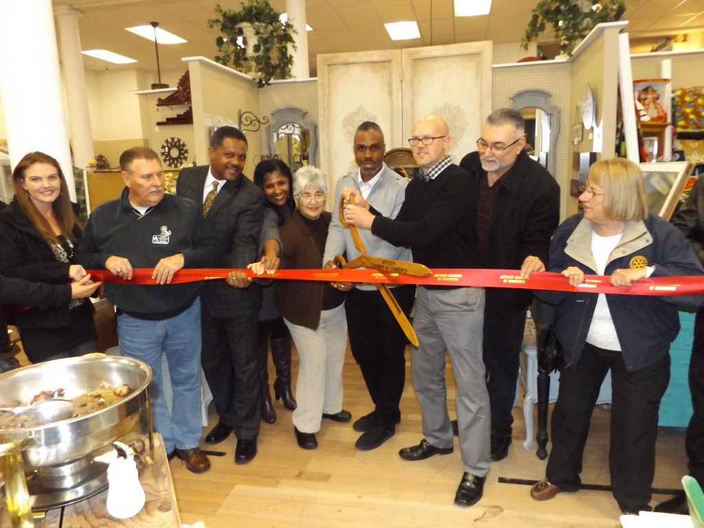 Antioch Chamber and City Council members join owners Brandon Woods and Michael Gabrielson (with scissors) for the ribbon cutting to officially open their new G St. Mercantile store in downtown, Friday evening, January 15th.