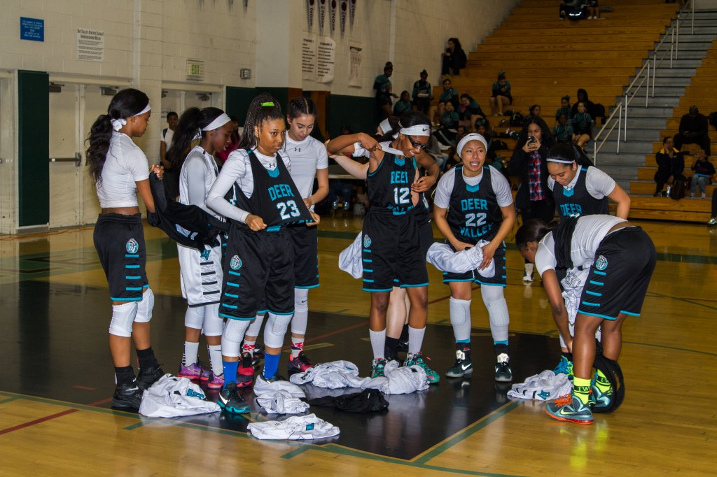 Deer Valley girls basketball team members remove their jerseys in protest before the game on Thursday, February 11, 2016. photo by Michael Pohl