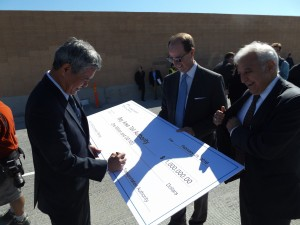 Iwasaki of the CCTA signs a ceremonial check for the leftover funds totaling $1 million, as Steve Heminger, Executive Director of the Metropolitan Transportation Commission and Bijan Sartipi, Region IV Director for CalTrans look on.