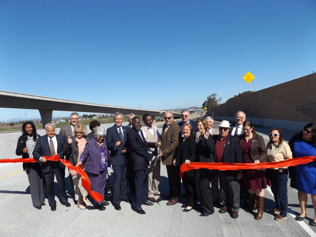 Officials celebrate after cutting the ribbon on the new Highway 4/160 northbound ramp on Monday, Feb. 29, 2016.