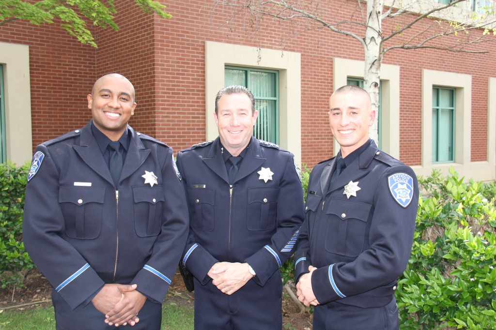 New Antioch Police Officers German Blanco, left and Chris Motle, with Chief Allan Cantando following their oath of office ceremony, Monday, March 21. photo by APD