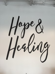 The slogan of Fellowship Church Hope & Healing on the wall inside the new church building.